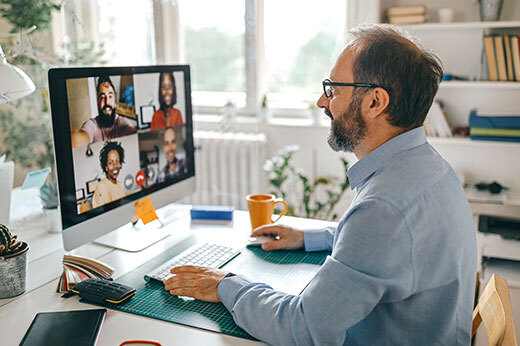Man on a conference video call